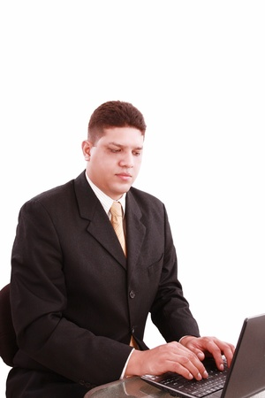 business man on a laptop in an office Stock Photo - 11701384