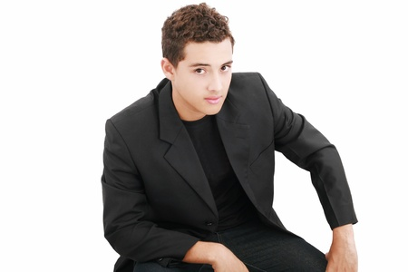 Young casual boy posing isolated on white  photo