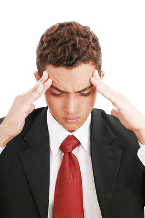 superior: Attractive young man suffering from headache. All on white background.  Stock Photo