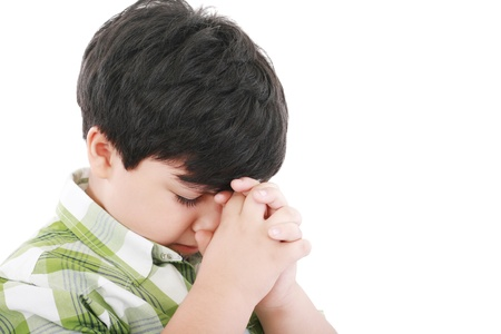 revere: A boys prays earnestly to his creator in heaven   Stock Photo