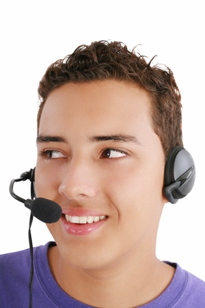personal assistant: Smiling businessman talking on headset against a white background