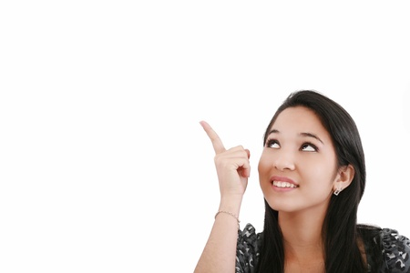 Attractive young woman points to something above her head  photo