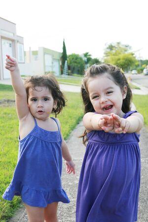Beautiful little girls enjoying outside   photo