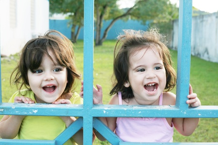 Portrait of happy two sisters outdoors having fun  photo