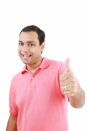 Portrait of a happy young man showing good job sign against white background  photo
