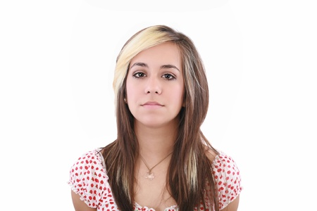 frontal view: Young serious attractive woman looking into the camera