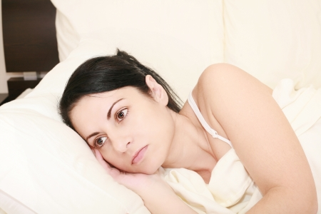 worried: Worried woman in the bed