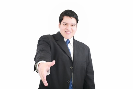 Handsome executive extending hand to shake Stock Photo - 12222341
