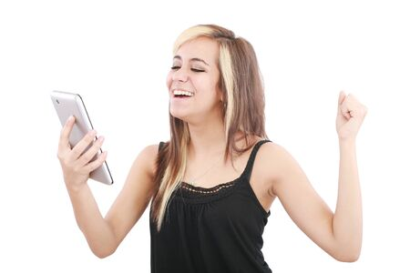 Tablet computer woman excited looking at touch pad pc Stock Photo - 12222347