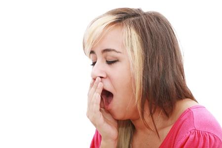 Yawning tired woman, caucasian model isolated on white background. Stock Photo - 12222358