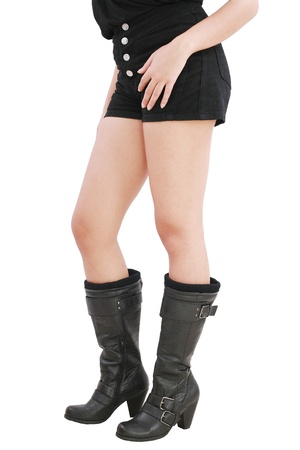 hither: young sexy woman wearing black shorts and boots Stock Photo