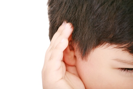 heed: A little boy trying to hearing the sound around him - What did you say