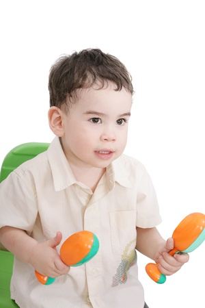 boy with maracas, isolated on white photo