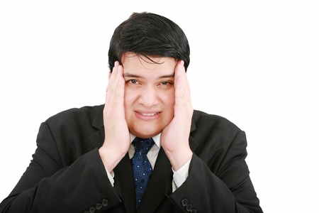 Close-up of a businessman with a migraine holding his temples  Stock Photo - 12534448