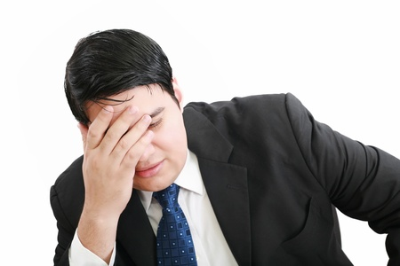 Portrait of a young business man depressed from work against white background Stock Photo - 12534453