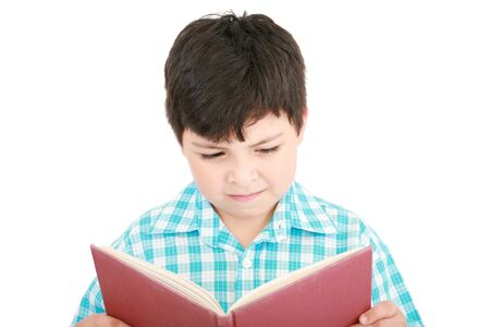 boy book: Small boy reading a book on a white background
