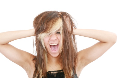 going crazy: Stress  Woman stressed is going crazy pulling her hair in frustration  Close-up of young businesswoman on white   Stock Photo