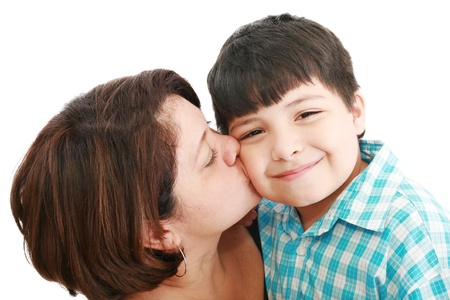 mom kiss son: Adorable mother kissing her beautiful son isolated on white background