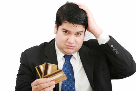 glaring: Upset robbed man glaring at his many credit cards  Stock Photo