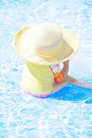 fashion toddler girl playing in swimming pool Stock Photo - 12838350