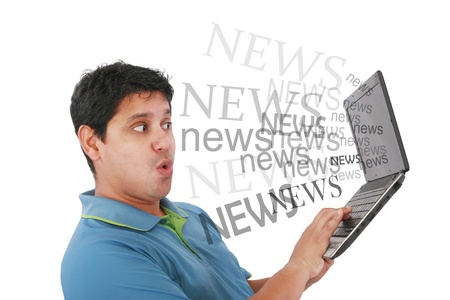 Man in laptop with the word news coming out of the screen photo