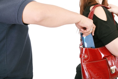 man pickpocketing a purse from womans bag   photo