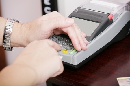 entry numbers: Human hand enter atm banking cash machine pin code
