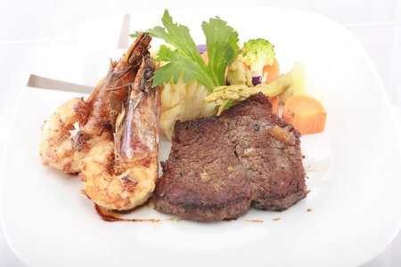 Steak with Jumbo Shrimp   Stock Photo - 13149428