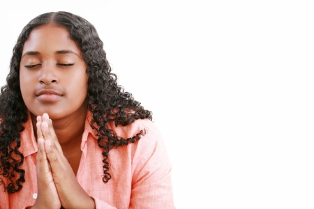 woman praying isolated on a white background. Stock Photo