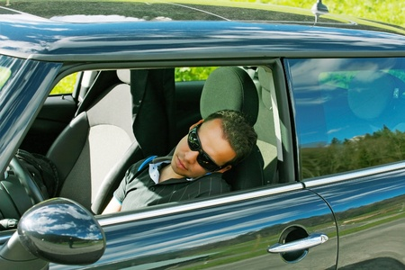 man sleeps in a car  photo
