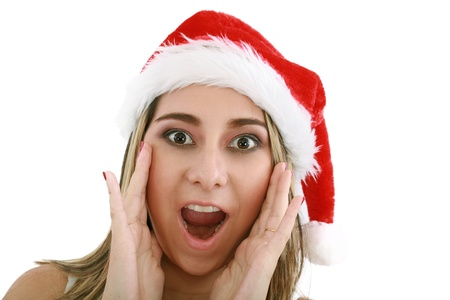 woman in santa hat surprised for Christmas.  photo