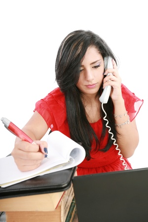 Busy businesswoman using mobile phone and take note Stock Photo - 14426904