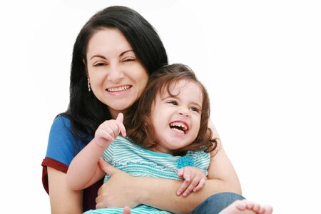 Closeup of happy young mother having fun with her daughter photo