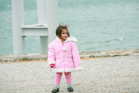 Little girl wearing winter outwear photo