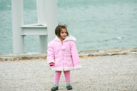 outwear: Little girl wearing winter outwear