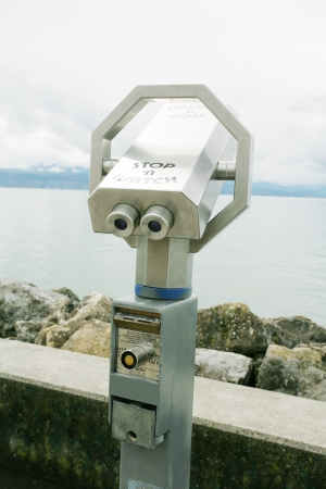 Silver coin operated pay binoculars  photo