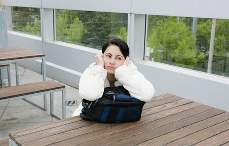 pullovers: Outdoor portrait of a sad woman looking thoughtful about troubles