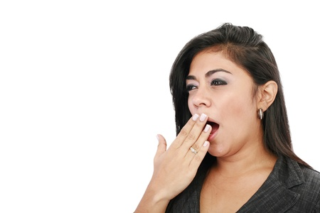 Close-up portrait of a business woman yawn, isolated on white background