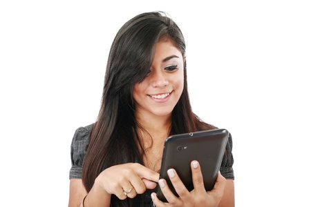 Woman holding tablet computer isolated on white background. working on touching screen. Casual smiling caucasian hispanic woman.  Stock Photo - 14695228
