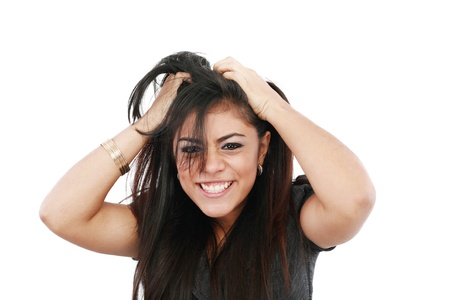 A portrait of a young frustrated woman pulling out hair over white background  photo