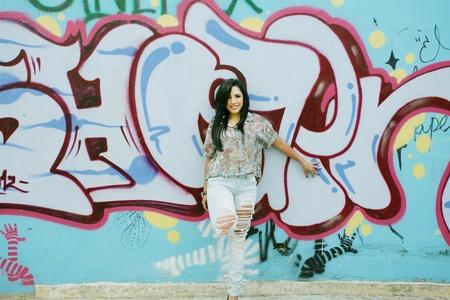 grafiti: Girl against grafitti wall Stock Photo