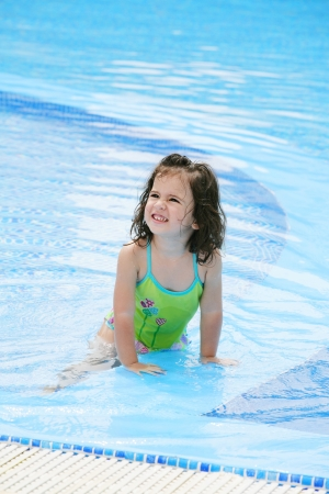 happy girl in the swimming in swimming suit  photo