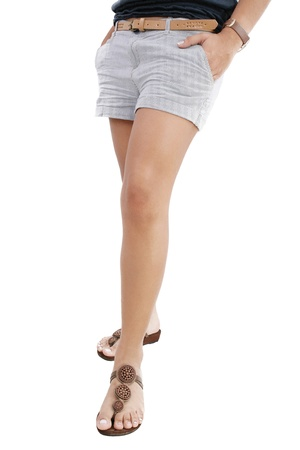 Woman legs with hot pants on white background  photo