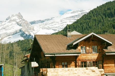 chalets: Lovely Swiss chalet with mountains in background