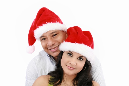 Young couple at Christmas with Santa Claus hats Stock Photo - 15199712