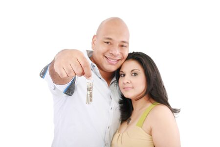 Young smiling couple holding keys of their new house  Stock Photo - 15199727