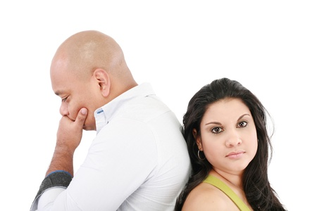 Young couple standing back to back having relationship difficulties on white background  Stock Photo - 15199756