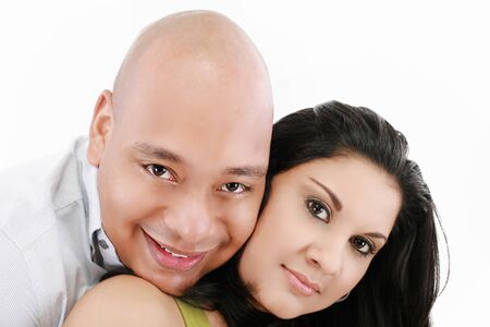 Portrait of a beautiful young happy smiling couple - isolated Stock Photo - 15199747