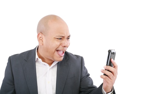 Angry business man screaming on cell mobile phone, portrait of young handsome businessman isolated over white background, concept of executive yelling, conversation problem communication crisis  photo
