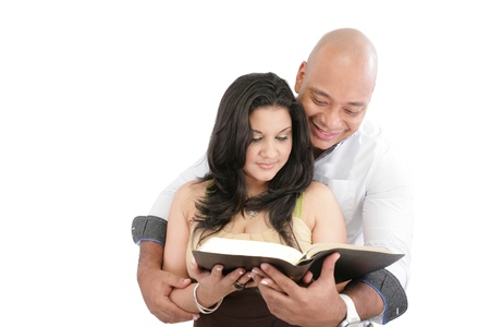 Attractive couple reading the Bible  photo